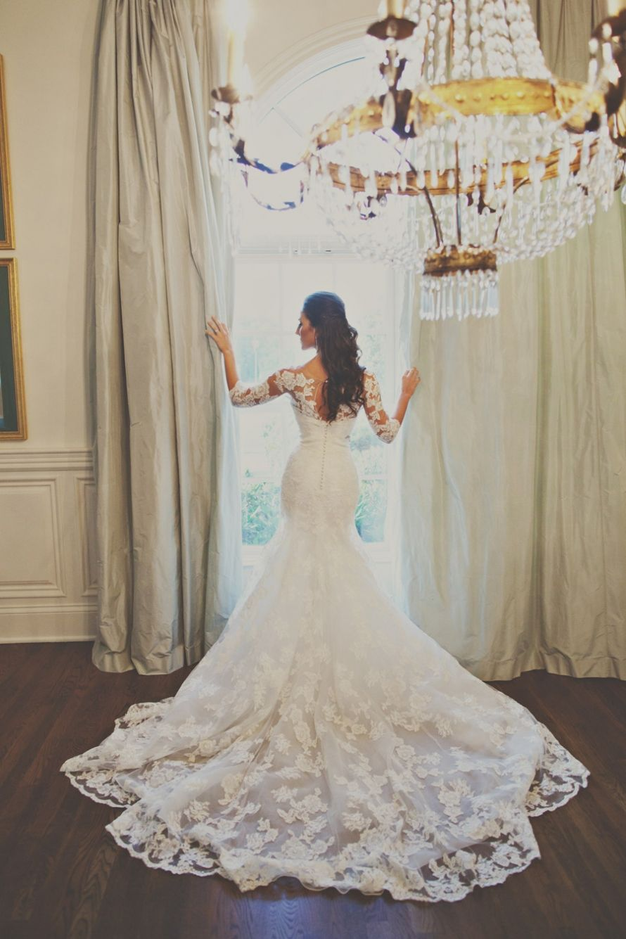 Long beautiful lace train and buttons down the back wedding
