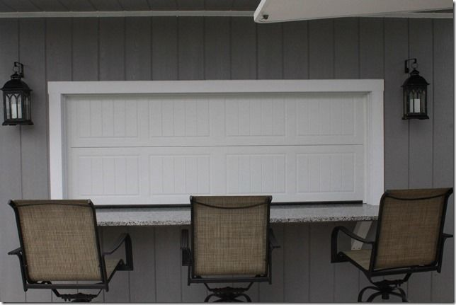 Outdoor Pool Bar With A Steel Garage Door To Protect The Inside