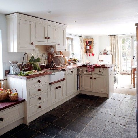 White Fitted Sunlit Kitchen With Grey Tiled Floor