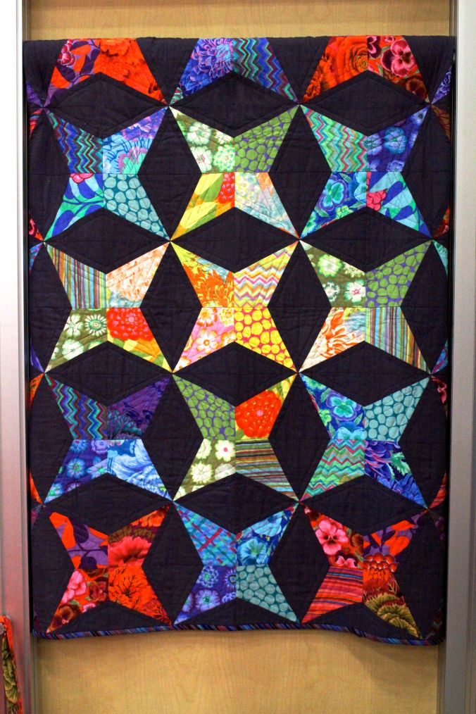 Come walk the Market floor with 2015 Fall Quilt Market Part 3! You will see booths from Robert Kaufman Fabrics, Moda Fabrics United Notions, Art Gallery Fabrics, FreeSpirit Fabrics, Birch Fabrics and Michael Miller Fabrics!   There will be one more post tomorrow from the Quilt Show floor!   https://auribuzz.wordpress.com/2015/10/31/2015-fall-quilt-market-part-3/