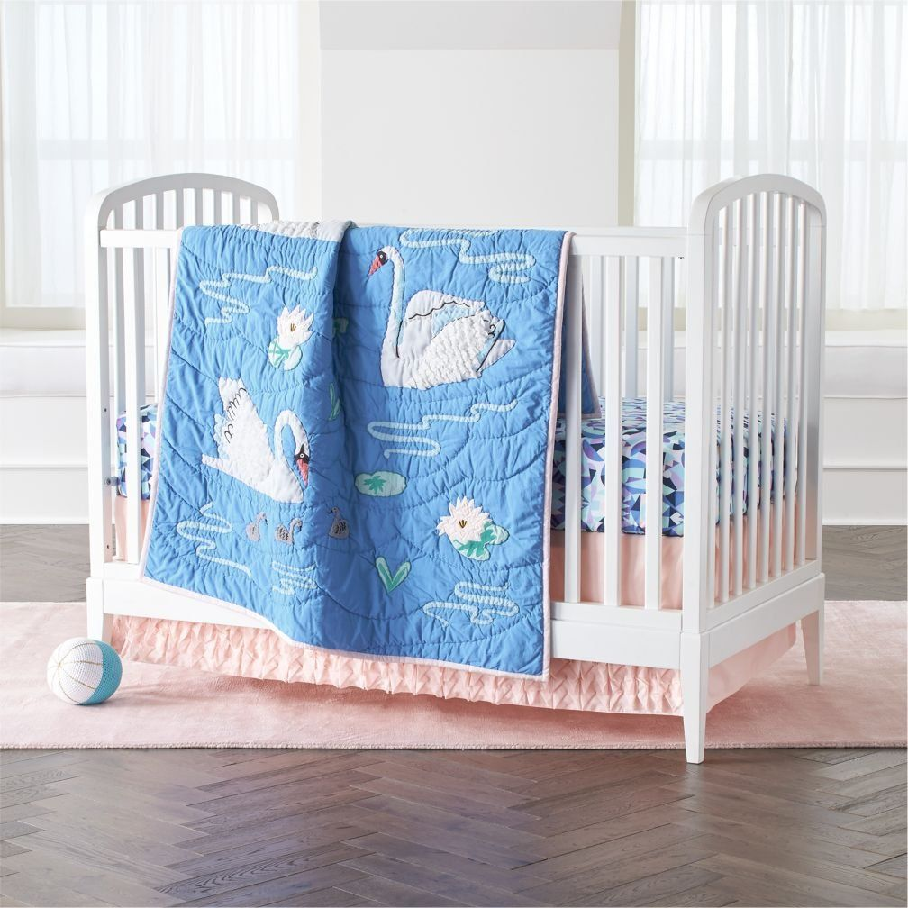 Shop Swan Crib Bedding.  Our Swan Crib Bedding will make a graceful addition to any nursery.  The baby quilt has attractive embroidery, ruffled swan wings and velvet water lilies, while the coordinating crib fitted sheet was made from 100% organic cotton.