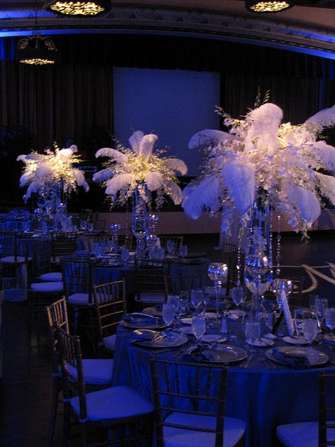 Centerpieces Bursting With White Orchids And Feathers
