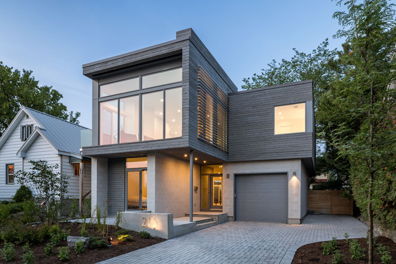 Honed Concrete Block Walls And Grey Stained Cedar Siding Are Showcased In The Design Of This New House In 2020 Concrete Block Walls Cedar Siding Concrete Blocks