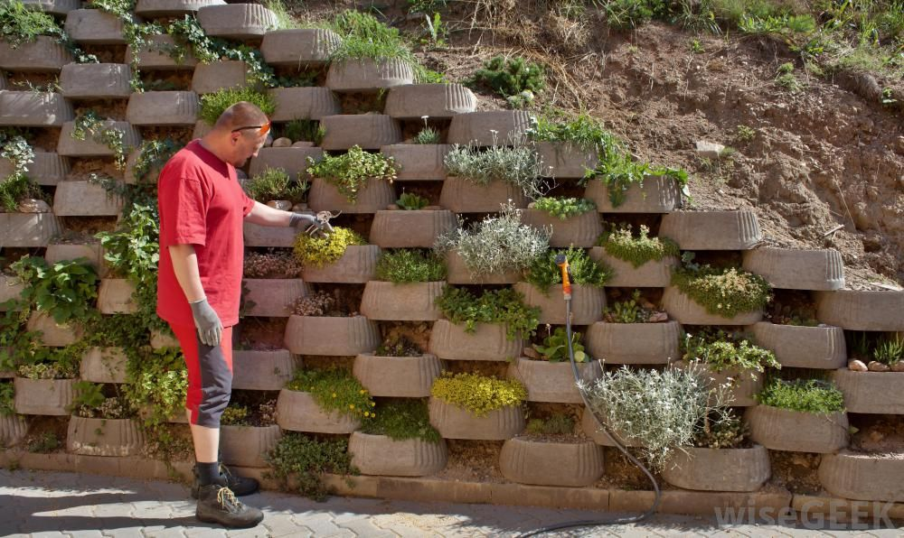 Some retaining walls even leave room for the addition of for Block garden wall designs