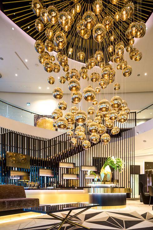 Tom Dixon Mirror Ball large lighting sculpture in Estonia's first Hilton Hotel