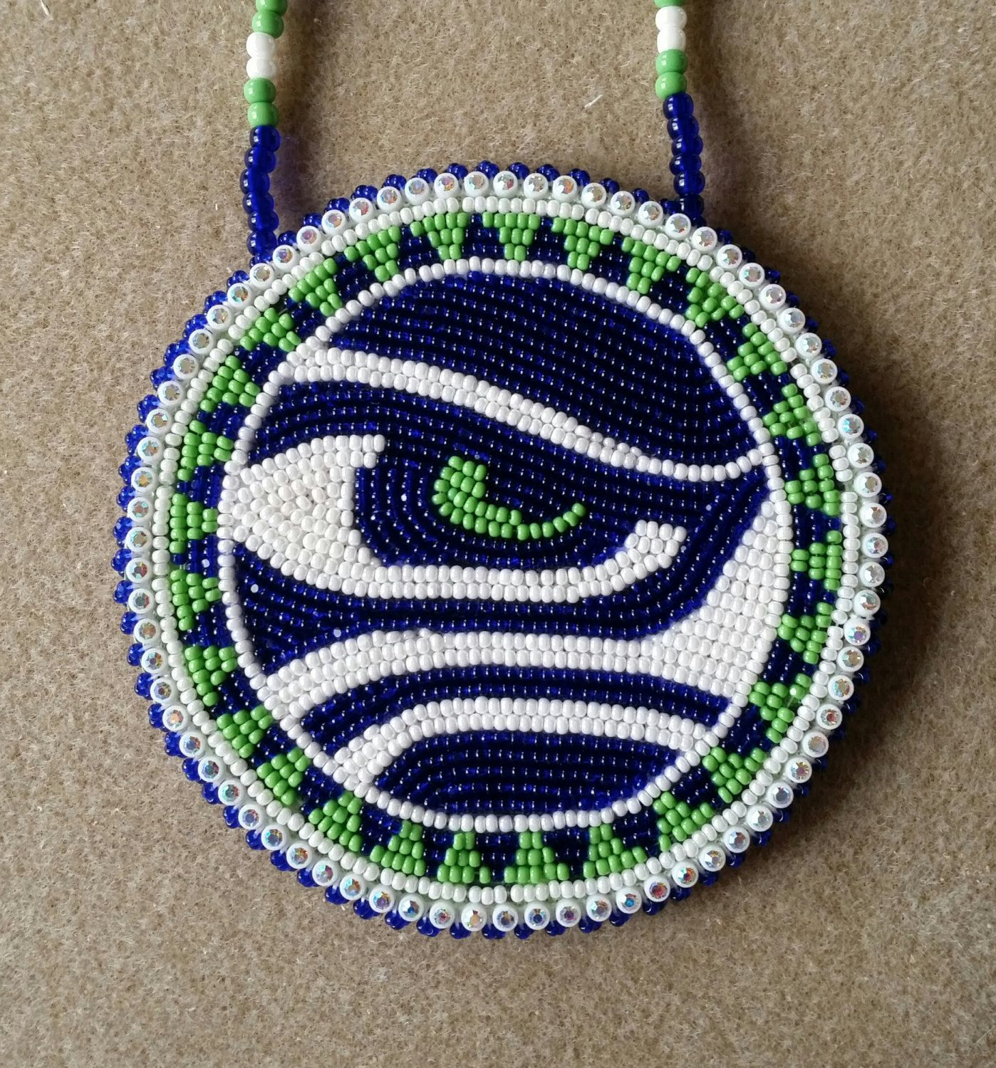 Native american beaded seattle seahawks eye medallion by for Sell gold jewelry seattle