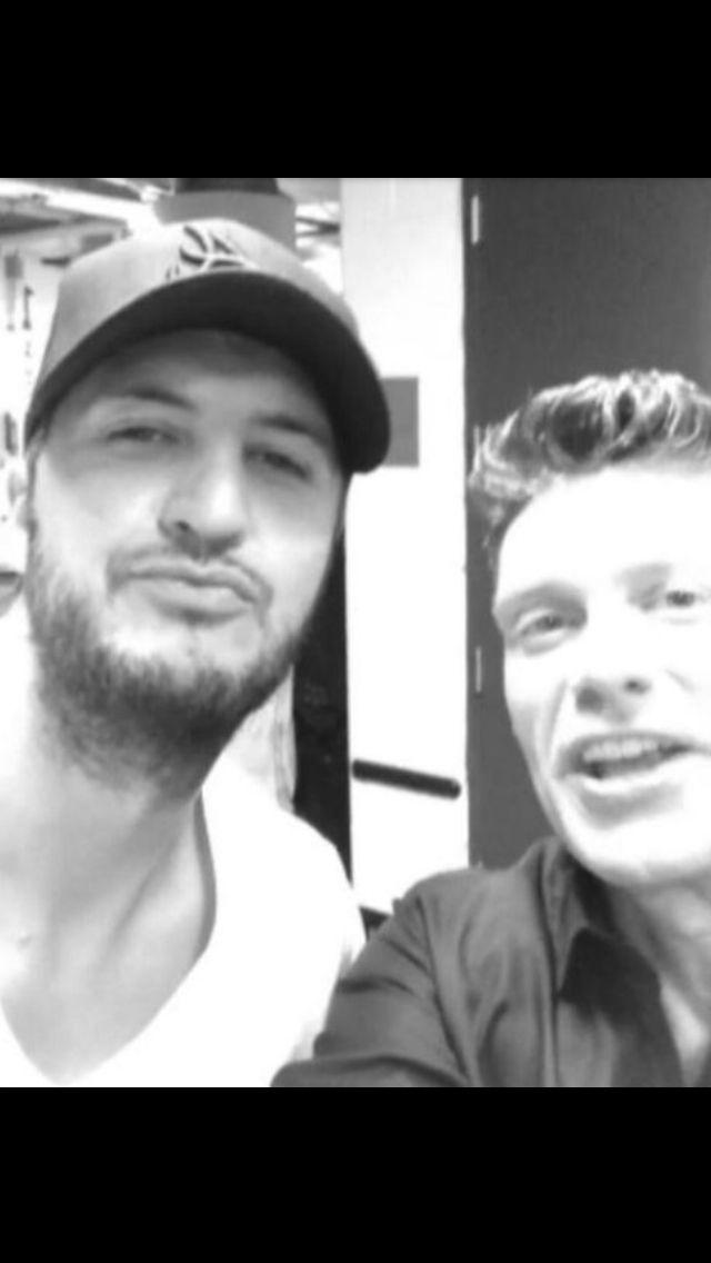 Luke with Ryan Seacrest