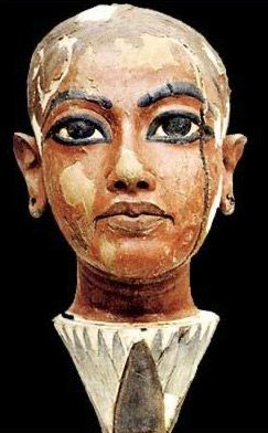 Painted wooden head of Tutankhamun as a child rising from the top of a lotus blossom.