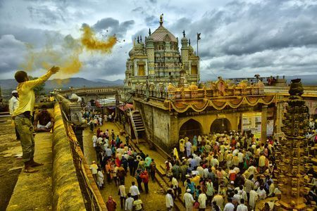 Devotee Offering His Bhandara To Family Deity Lord Khandoba At Holy Town Jejuri Jejuri Best Photo Background National Geographic