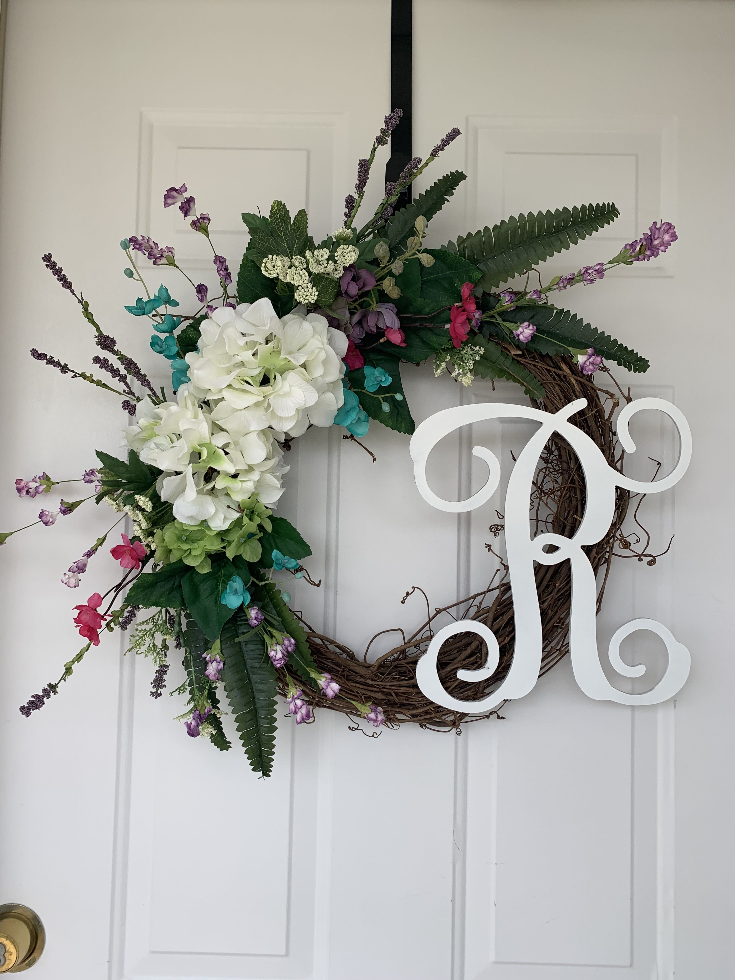 Spring Wreath Full Of Hydrangeas Spring Flowers And Tons Of Greenery Script Monogram Added To Complete The Lo Monogram Wreath Spring Wreath Hydrangea Wreath