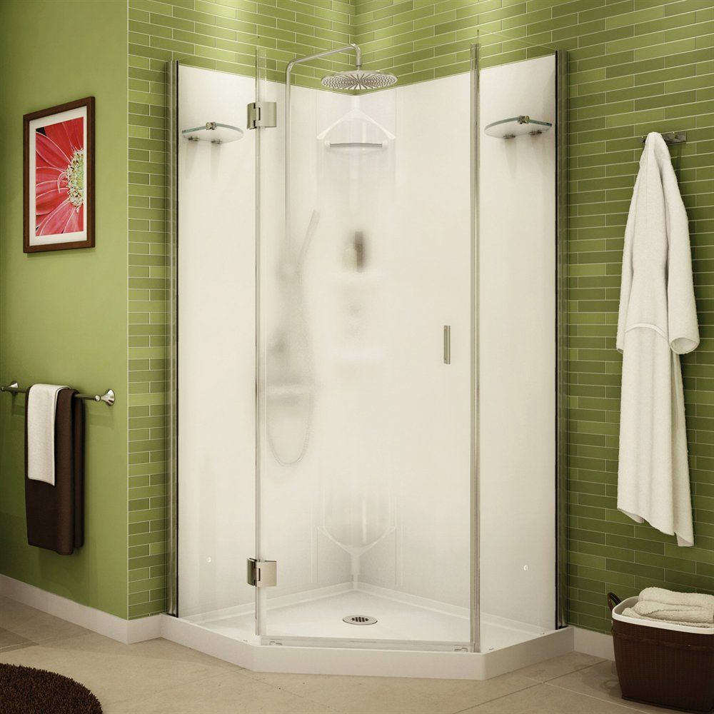 A shower stall with a reversible pivoting door and chrome hinges ...