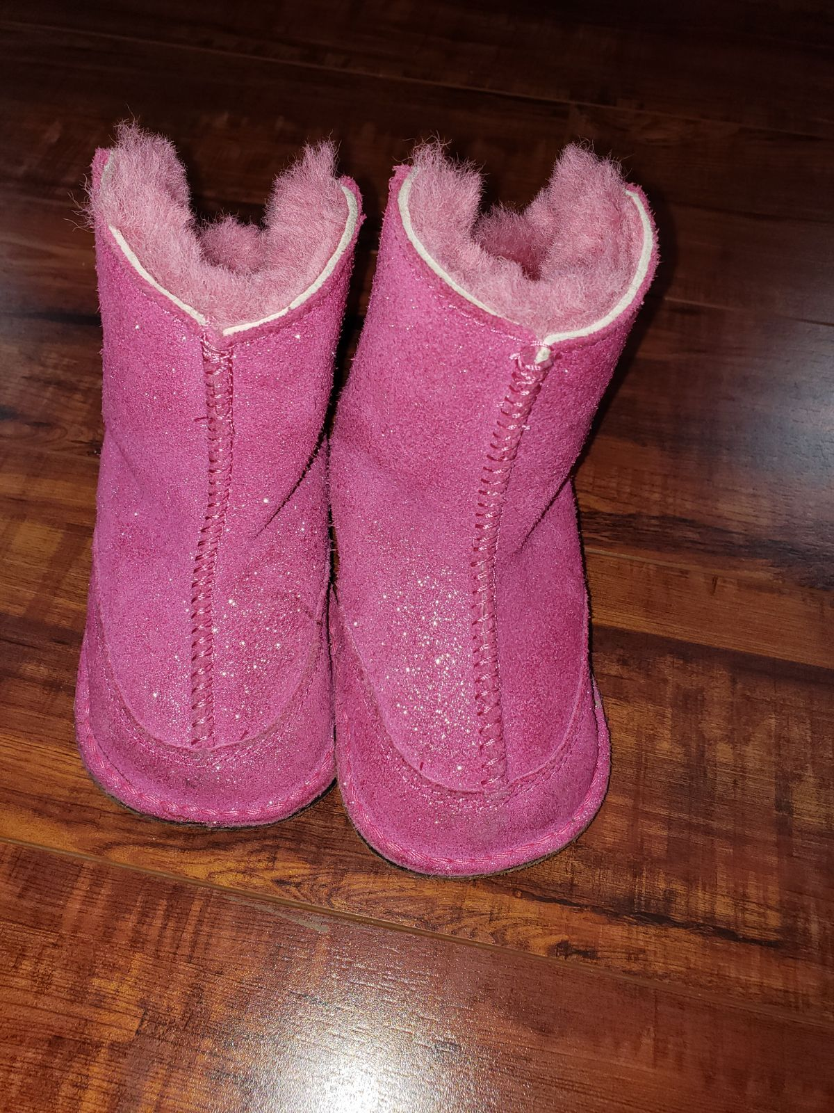 Baby girl pink ugg boots size M. They