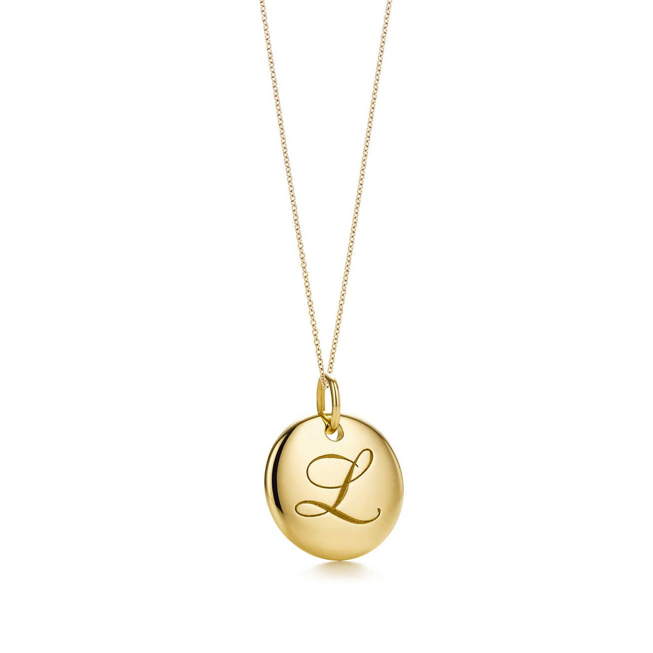 Tiffany Notes alphabet disc charm in 18k gold, small Letters A-Z available - Size K Tiffany & Co.