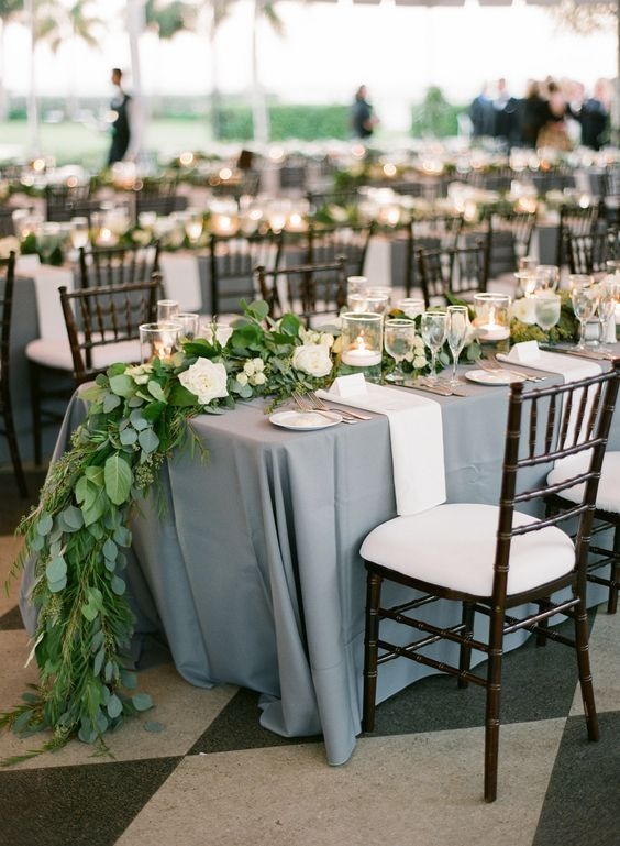 Dusty Blue Linen Color With Greenery And White Flowers Classic Wedding Tablescape More Wedding Wedding Table Linens Yacht Club Wedding Dusty Blue Weddings