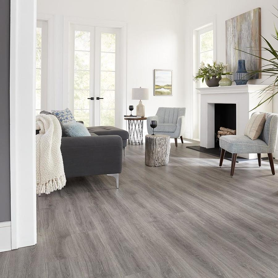 Pergo Portfolio Wetprotect Waterproof Trenton Oak 7 48 In W X 3 93 Ft L Embossed Wood Plank Laminate Flooring Lowes Com Grey Laminate Flooring Living Room Grey Laminate Flooring Grey Flooring Living Room