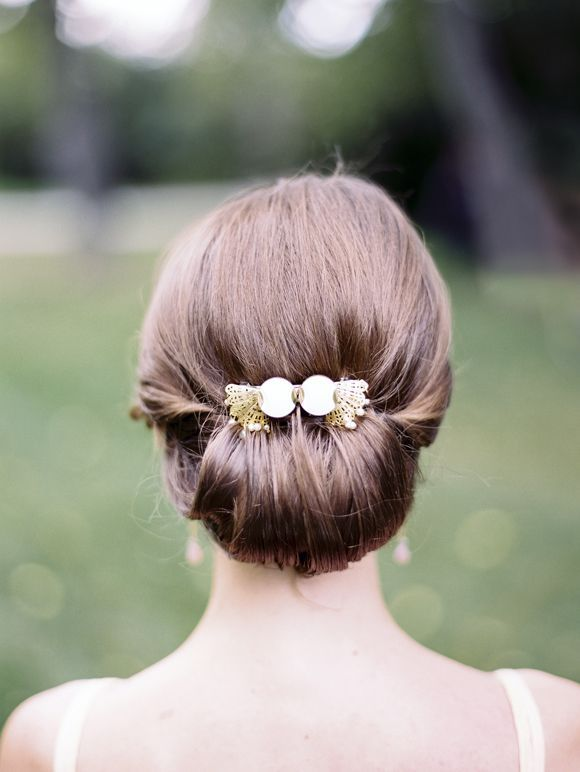 love this simple and elegant updo! Except I would add I headband or flowers, and maybe a veil
