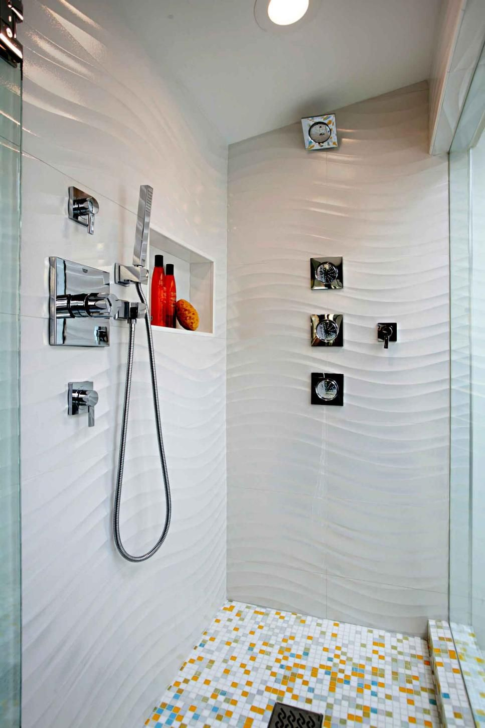 A Waved Effect On These Shower Walls Create A Water Like Movement