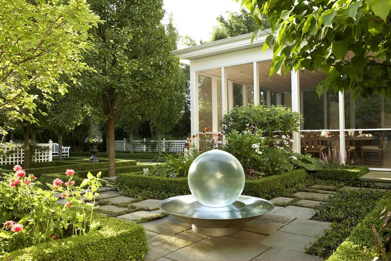 Residential   Glass Water Feature Atop Bluestone Paving Surrounded By  Formal Boxwood Garden. Photography By