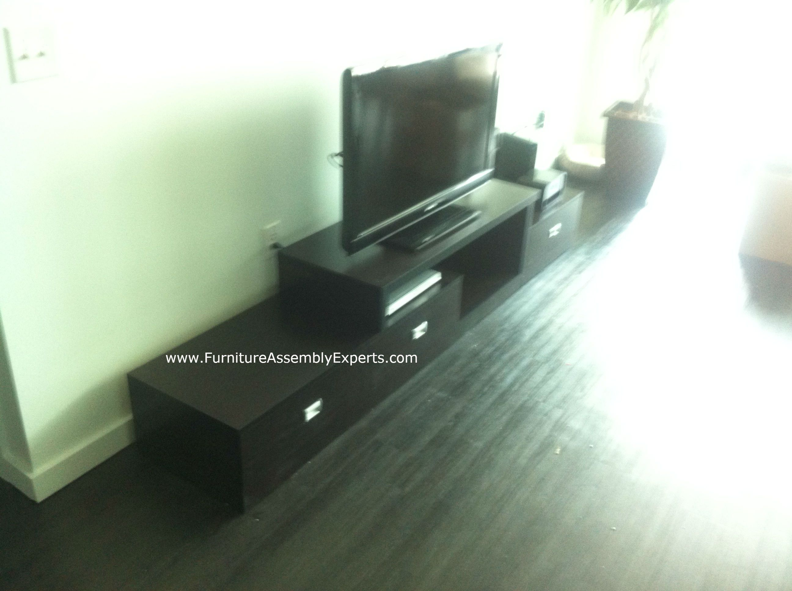 Overstock Marconi Brown Asymmetrical Modern TV Stand Assembled In Baltimore  MD By Furniture Assembly Experts At