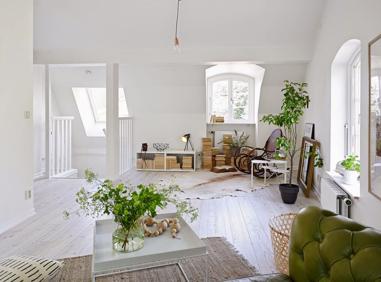 Natural plants and warm wood keep this living room from being too sterile