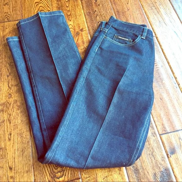 DKNY high waist denim High waist style in a dark wash. These are in excellent condition - never worn! Legs are pleat pressed for a sophisticated look. DKNY Jeans