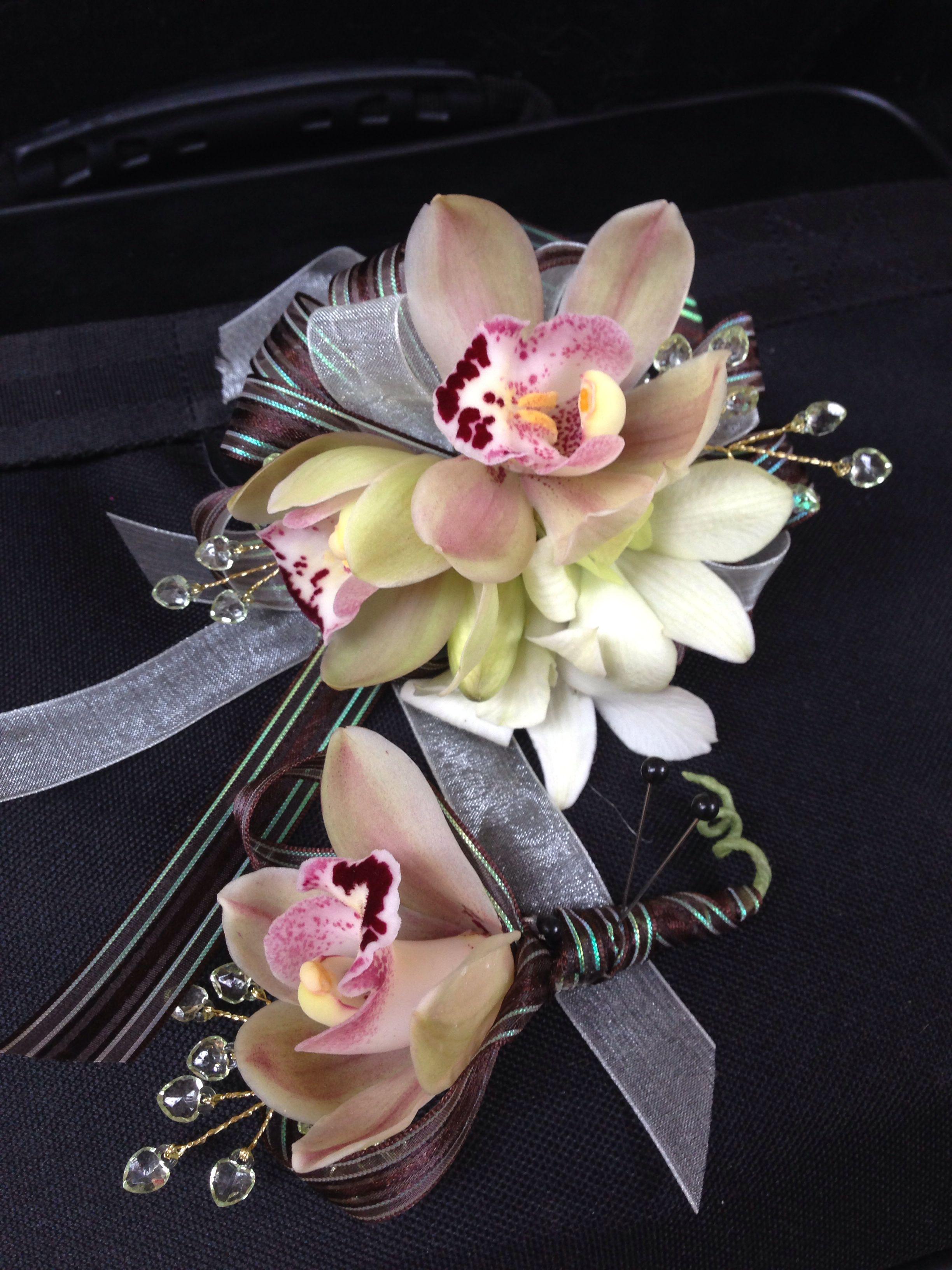 Beautiful blush cymbidium wrist corsage
