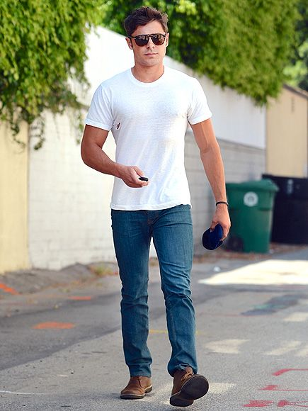 a4564ecd71323 HOLE-Y COW It might be time for a new shirt! A casually clad Zac Efron  emerges from a Beverly Hills office with a tear in his top on Thursday.