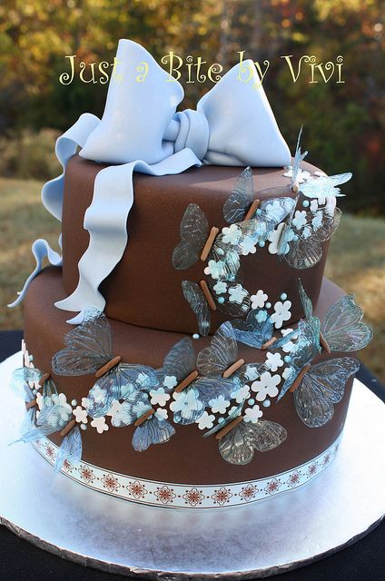 pretty brown and blue cake with butterflies
