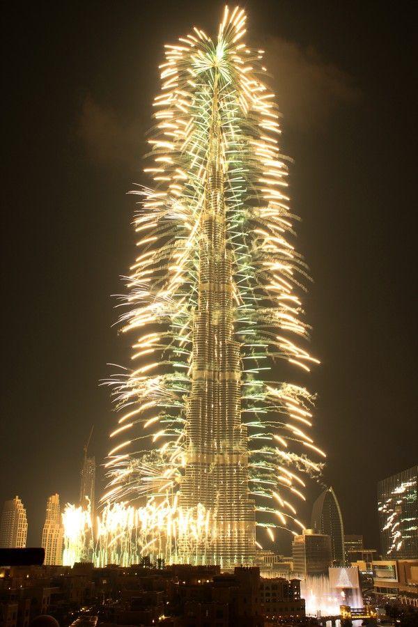 Fireworks around a big building.