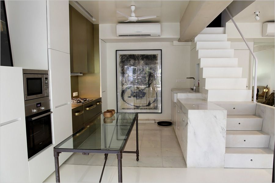 """Ashiesh Shah, an architect who has designed spaces for many Bollywood actors in Mumbai, bought the apartment in October 2009 and spent 5 million rupees to convert the space from a two-bedroom cramped duplex to an airy one-bedroom studio. Knocking down a total of nine walls, """"gave me freedom to place art pieces in a fluid, open space,"""" he said."""