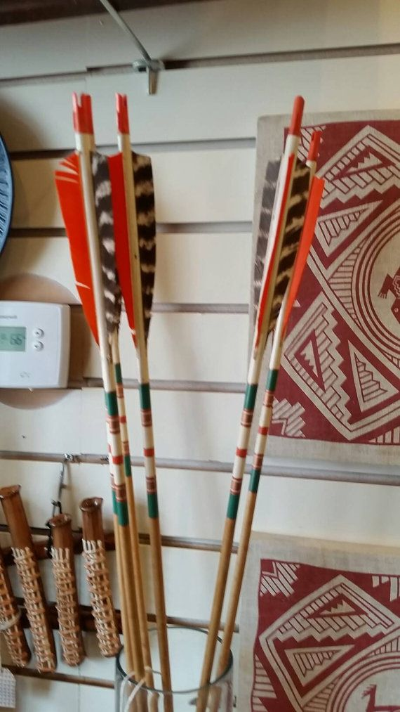 Check out this item in my Etsy shop https://www.etsy.com/listing/272767852/vintage-hand-painted-wood-archery-arrow