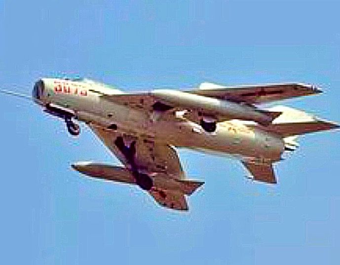 Chinese Air Force MiG-19 with external wing tanks  | MiG-19