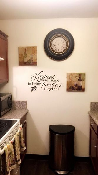 Family kitchen wall decal is the spotlight in this homey kitchen thanks for sharing your pictures