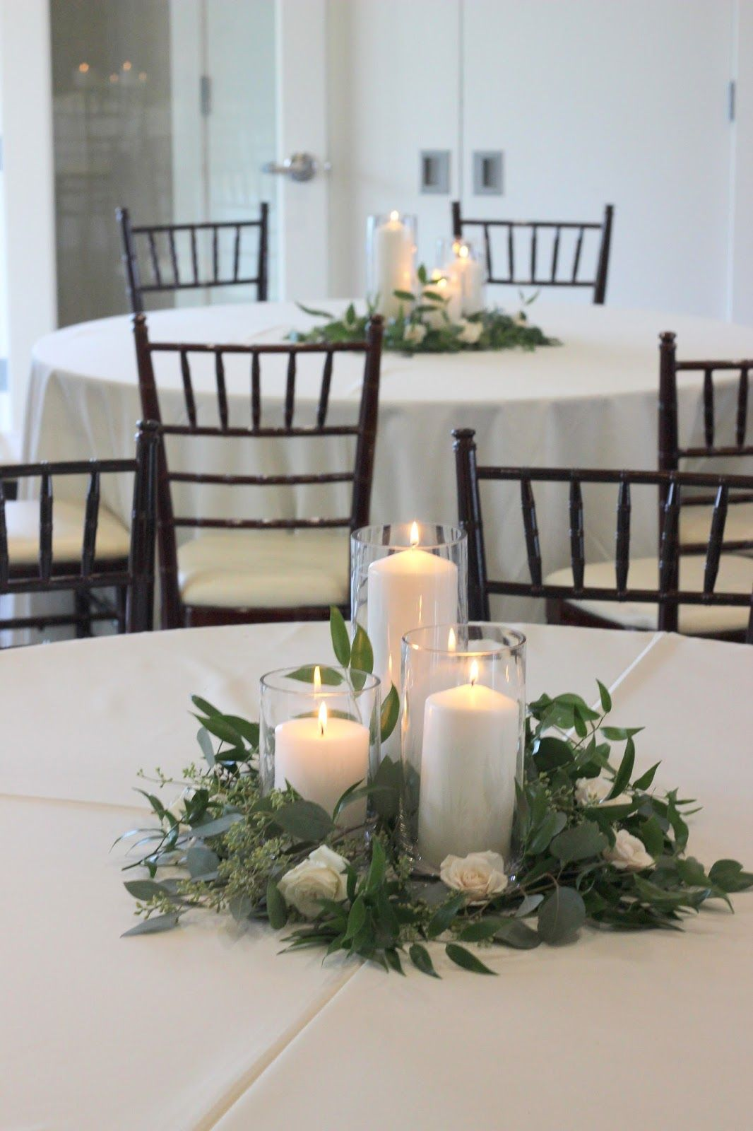 Greenery With Glass Cylinder Vade And Pillar Candles White Flower Wedding Center Peace All White