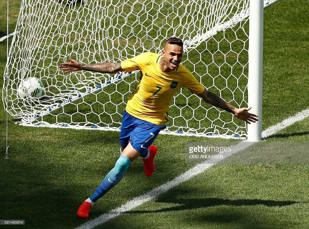 Brazil s Luan celebrates after teammate Neymar scored against Honduras during  their Rio 2016 Olympic Games men s football semifinal match at the Maracana  ... ef755bb825393