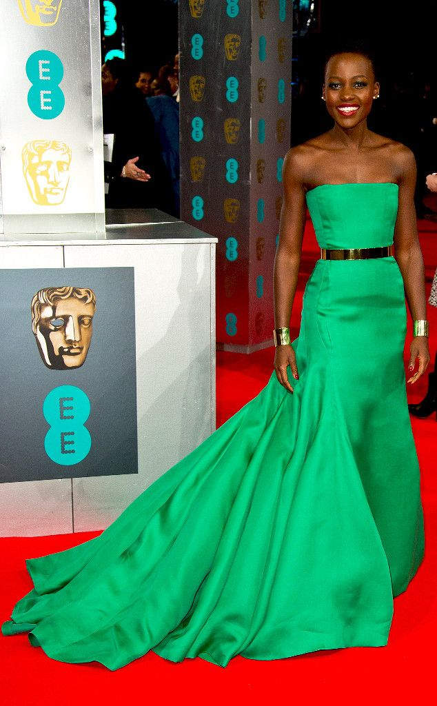 Lupita Nyong'o continues to wow this award season! For the BAFTAs, she donned an emerald green Christian Dior Haute couture gown with a gold belt and matching cuffs.