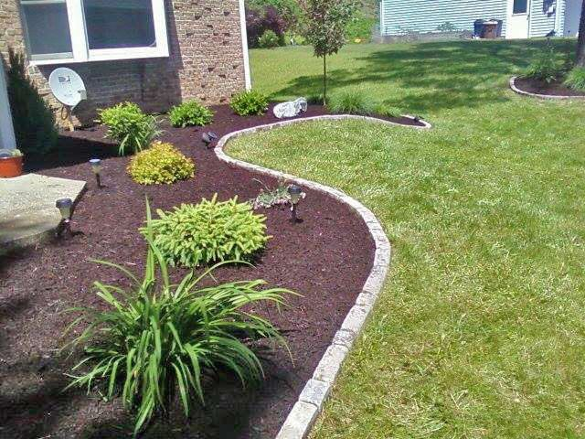 all season foundation planting with paver edging