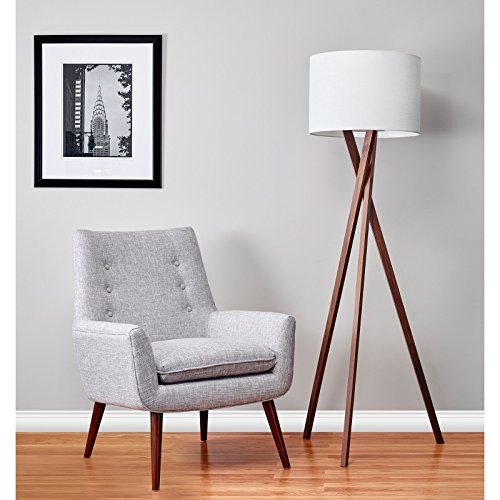 Adesso 3227-15 Brooklyn Floor Lamp  Hot legs! A sleek light walnut tripod base suits a variety of settings from contemporary, masculine, transitional to loft style. The legs attach to a metal disc that supports the socket and white textured linen shade. Overall height is 63″and the tripod base has a 17″ footprint. Lamping is a 150-watt three-way incandescent or three-way CFL bulb. Light walnut tripod base. Light walnut tripod base. White textured linen drum shade. Light walnut tripod..