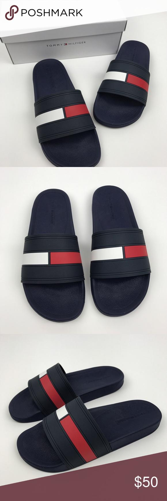 1db0338c7d86  Tommy Hilfiger  Men s Flag Logo Slides Sandals 10 Tommy Hilfiger Ernst.  Dark navy blue slip on sandals. Red and white flag logo across the strap.