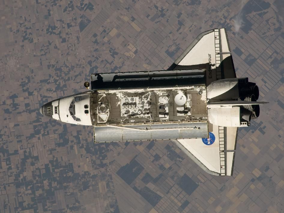 Endeavour in space with the payload bay doors open. Nasa