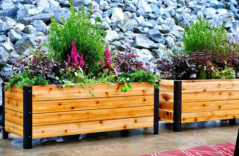 20 Planter Boxes You'll Want to DIY Right Now is part of Diy planters outdoor, Garden boxes raised, Garden boxes diy, Diy planters, Diy outdoor planter boxes, Outdoor planter boxes - There's no denying that traditional gardens are gorgeous, but they require a lot of work  For those of us who have small backyards, busy schedules, or may want to switch plants out or around the yard, a traditional garden can be hard to maintain  Planter boxes are a great solution for both gardeners without space, and for gardeners without a lot of time  They're perfect for keeping quickspreading plants (like bamboo) contained and under control  Yes, planter boxes are a great solution to a lot of gardening problems, but plastic or terra cotta planters can look cheap and clash with