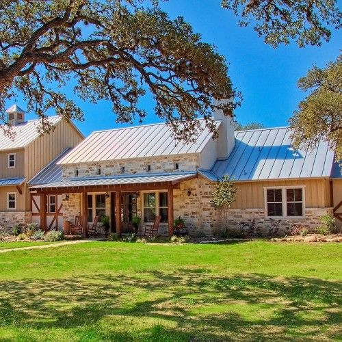 German farmhouse stucco prado crossing custom home for Texas hill country stone homes