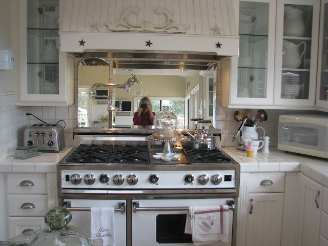 White Ironstone Cottage Mirror Behind The Stove Lake House Kitchen Kitchen Cottage Kitchen