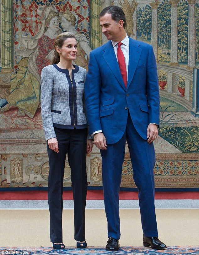 So stylish: The Queen of Spain looked chic in a tweed suit jacket, which she paired with blue suit trousers and blue court shoes at El Pardo Palace.