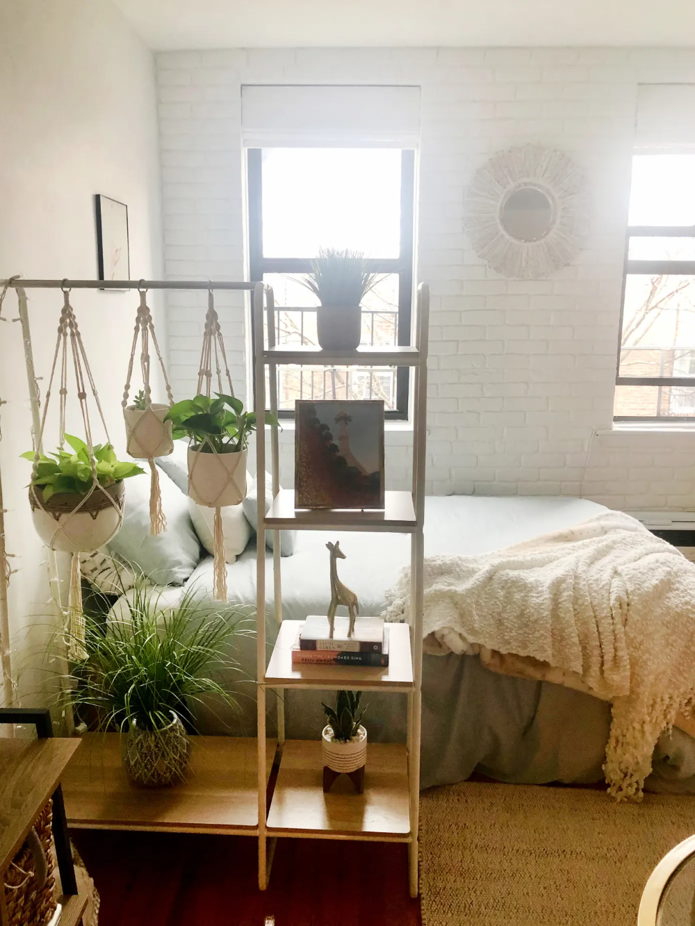 A 350-Square-Foot Studio Apartment Cleverly Repurposes a Clothing Rack as a Room Divider