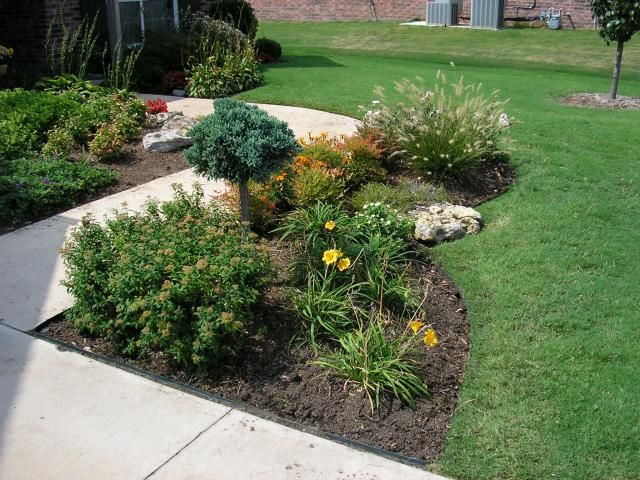 I like the flower bed shapes edge of driveway garden for Flower bed shapes designs