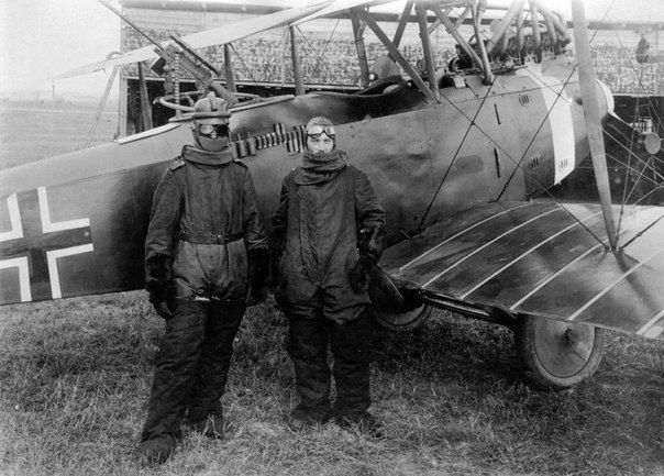 German pilot Richard Scholl and co-pilot Lieutenant Anderer in flight uniforms near biplane Hannover CL.II, 1918.
