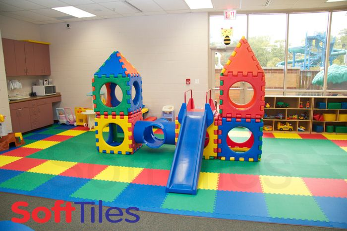 The sharonville recreation center used red yellow blue Playroom flooring ideas