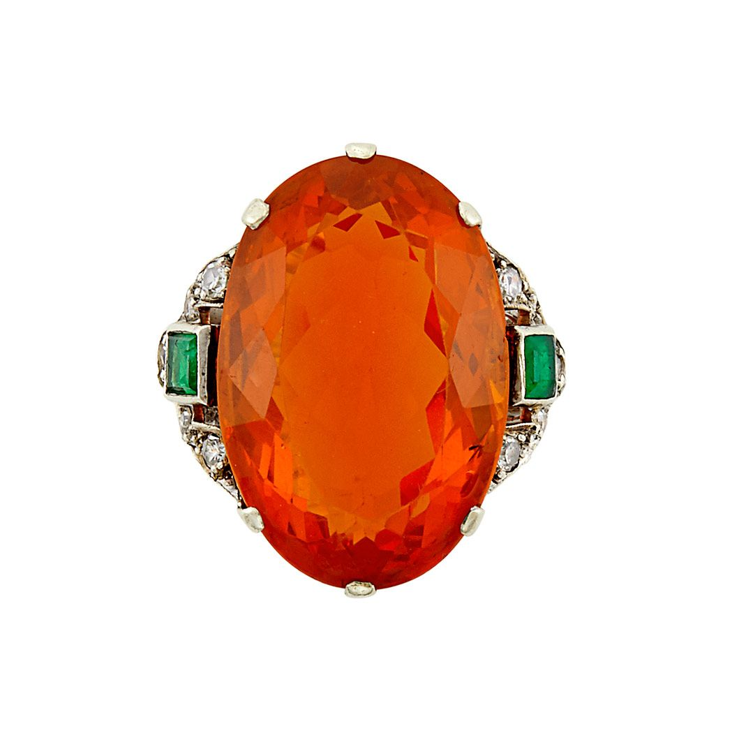 Fire opals are gorgeous and the emeralds in the setting really bring out the intense colour of this 15.75ct stone.