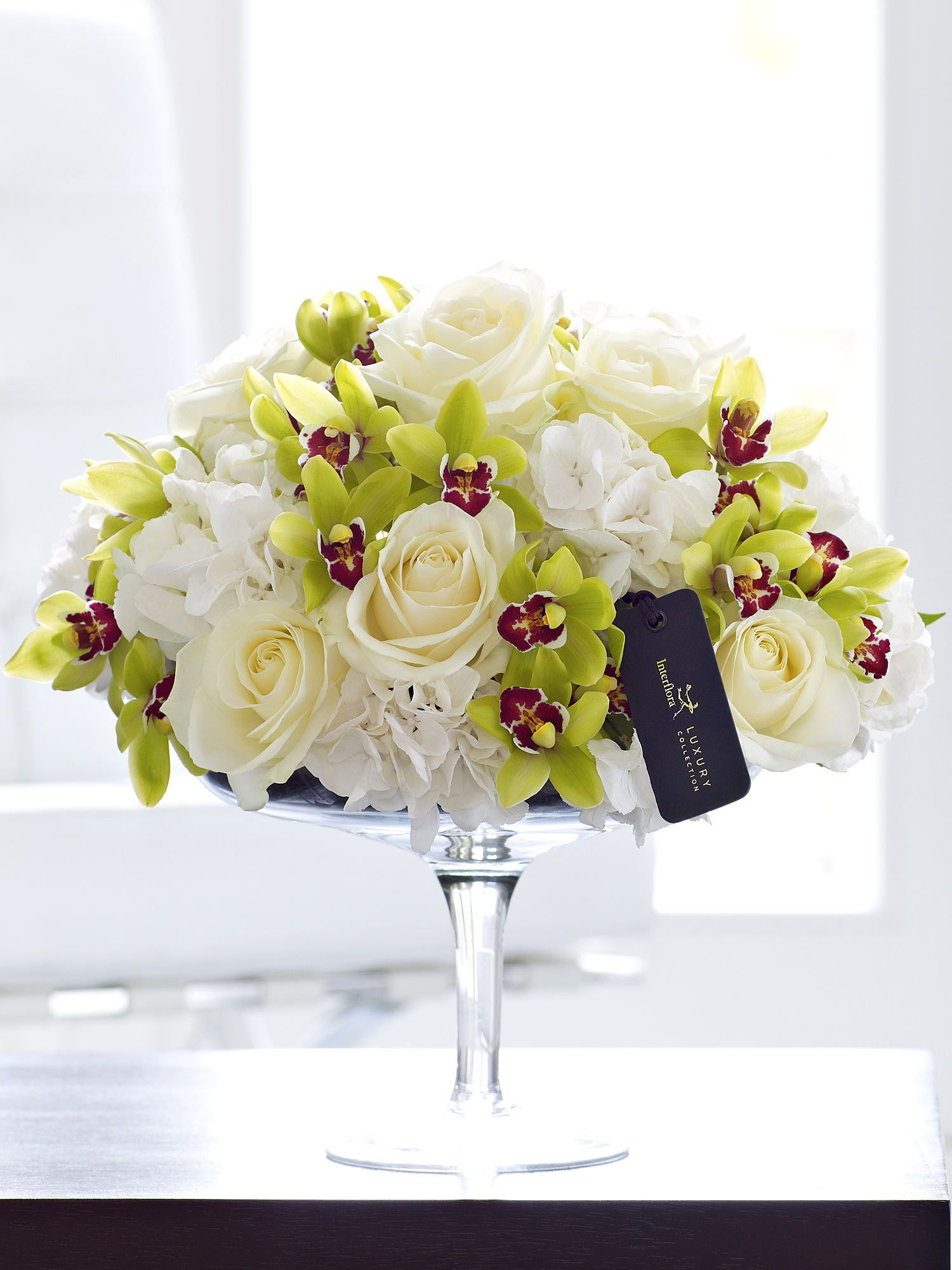 Luxury Rose, Hydrangea And Mini Cymbidium Orchid Arrangement  White